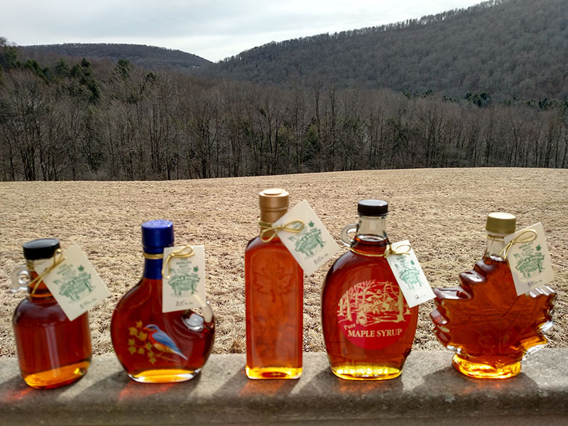 glass bottles of maple syrup